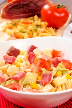 Close up to macaroni salad in white cup photo