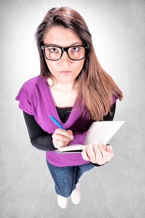 Female student from above on gray background Stock Photo - 18338853