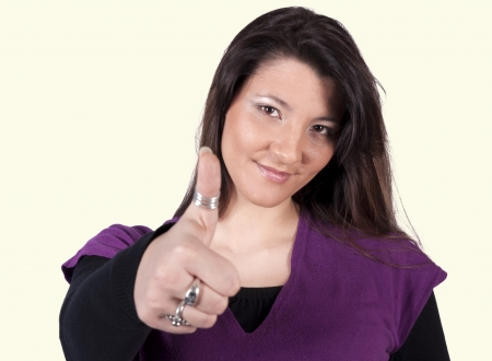 Positive woman showing the ok sign. Selective focus on the femal head Stock Photo - 18338761