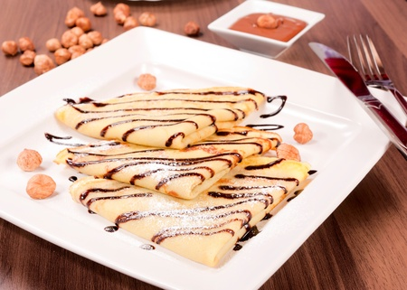 shrove tuesday: Sweet pancakes with chocolate nut cream. Selective focus on the front nacake