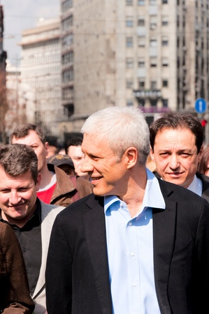 10 to 12 years:  BELGRADE, SERBIA - MARCH 12 Boris Tadic,ex-president of Serbia walk in honor of 10 years since the death of Serbian Prime Minister Zoran Djindjic on March 12, 2013 in Belgrade, Serbia.