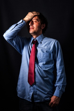 Businessman with the stress in low key technique Stock Photo - 18495641