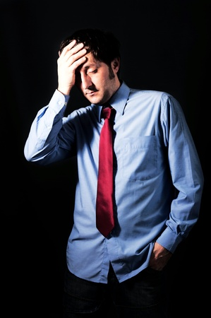 Sad businessman on dark background in low key technique light Stock Photo - 18562425