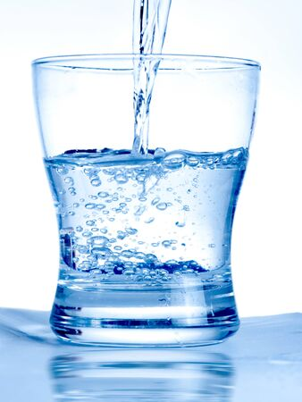 glass half full: Water flowing in a glass