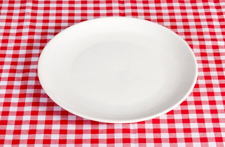 white plate: Empty white plate on the table