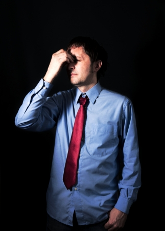 Businessman with the problems on black background Stock Photo - 18822006