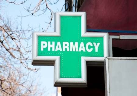 Green pharmacy sign on the street Stock Photo