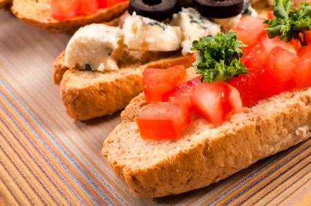 Selective focus on the fresh tomato bruschetta photo