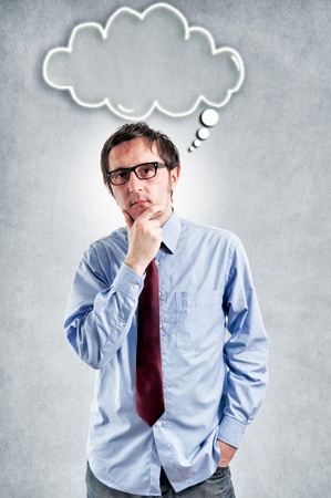 cogitation: Businessma thinking with the blank cloud over his head