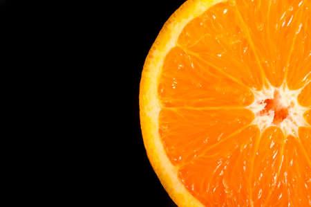 orange peel: Slice of orang on black background. Selective focus on the slice of orange Stock Photo