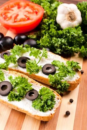 Fresh vegetarian bruschetta with olives and cheese photo