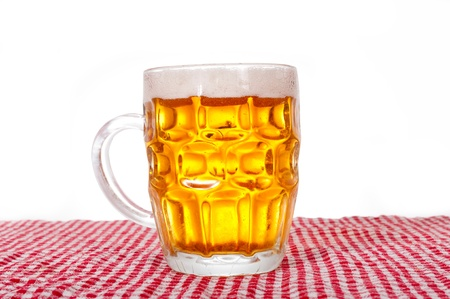Pint of beer isolated on white photo