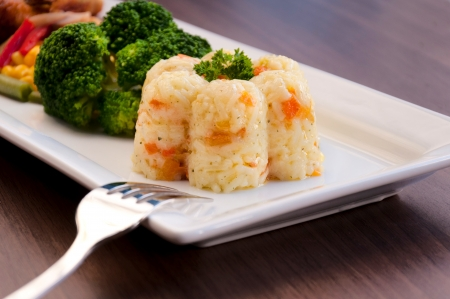 Prepared white rice with vegetables. Selective focus on the rice cup Stock Photo - 19198848