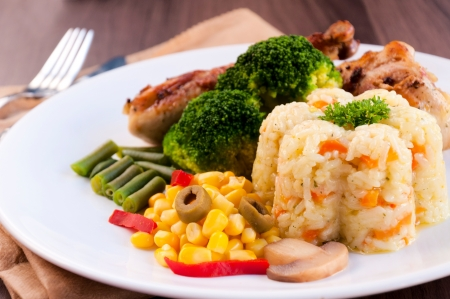 Rice and vegetables on plate. Selective focus on the rice and corn Stock Photo - 19198859