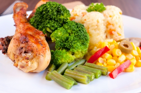 Prepared chicken leg and vegetables. Selective focus on the chicken leg Stock Photo - 19198861