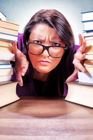 Red skin angry female student with books photo