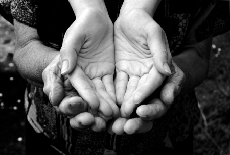 poor woman: Empty old and young hands in black and white Stock Photo