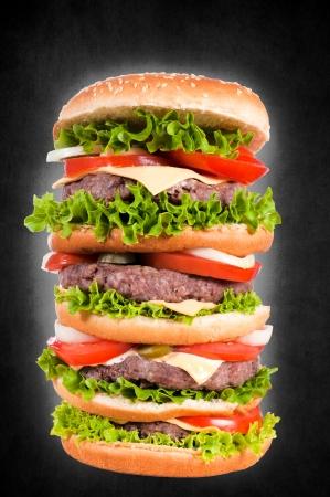 Big cheeseburger isolated on black Stock Photo - 19577244