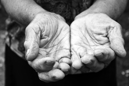 old beggar: Old female hands in black and white