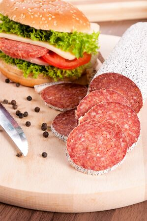 longaniza: Winter sausage slices with sandwich in background