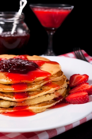 Pancakes with fresh homemade strawberries jam photo