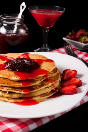 Traditional pancakes with strawberries jam photo
