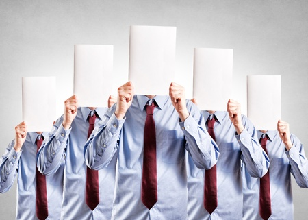 hyperspace: Businessmen holdings blank papper over their heads