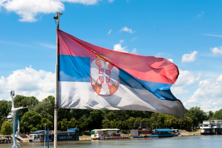 Official Serbian flag  over the sky  photo