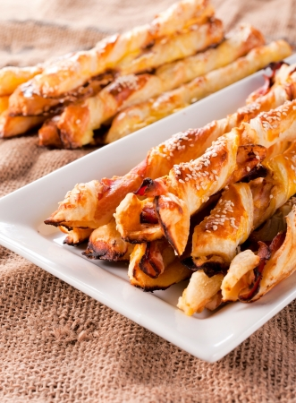 sesame cracker: Pastry snack with cheese and bacon