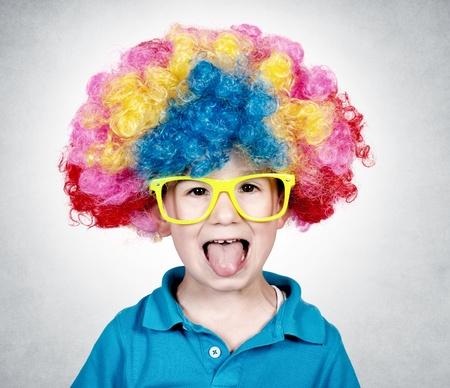 birthday clown: Little boy wearing clown wig and mocks Stock Photo