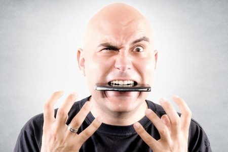 Bald guy eating mobile phone