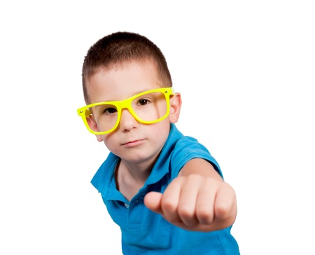 wallop: Little boy knocking isolated on white background. Selective focus on the boy head