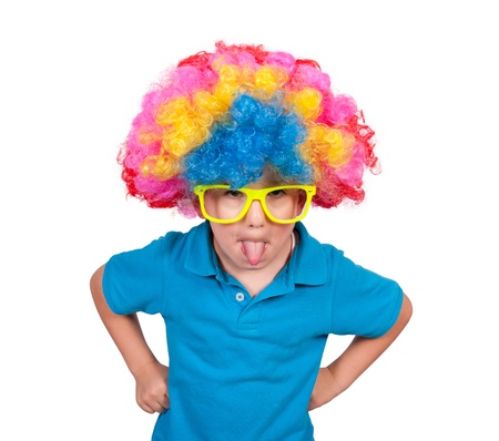 Little boy with clown wig mocking isolated on white background  photo
