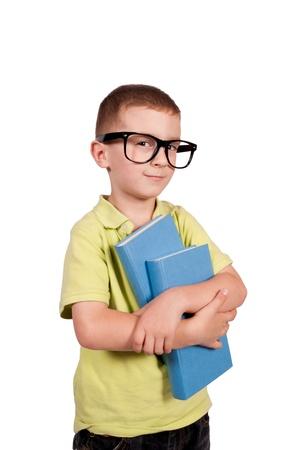 Smart boy holding the books isolated on white background  photo