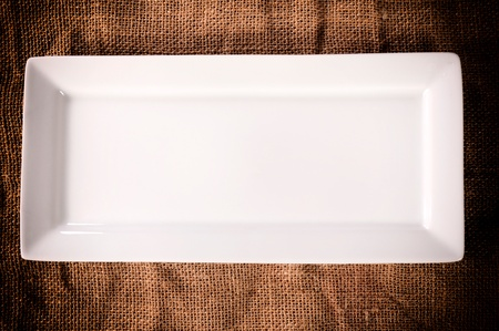 white plate: Empty white plate on the abstract background from above