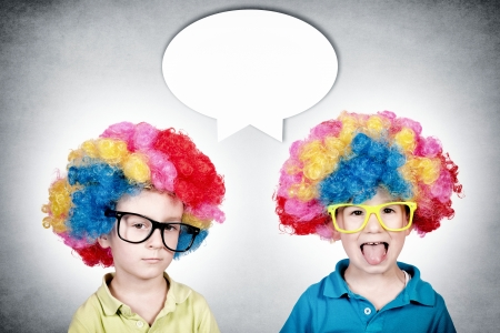 mocks: Happy and bored twins with the clown wig  Stock Photo