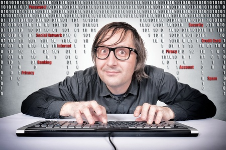 Funny hacker in action on his keyboard photo