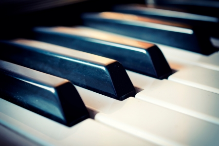 piano closeup: Selective focus on  piano black key in the middle