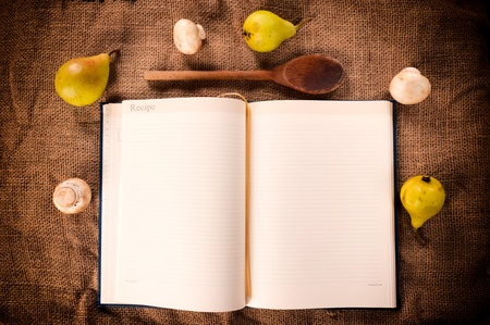 Cookbook with mushrooms and pear from above photo