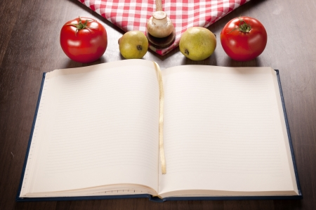 Empty cookbook and organic food on the wooden table  Banco de Imagens