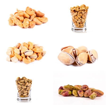 Pistachio and cashew nuts isolated on white background  photo