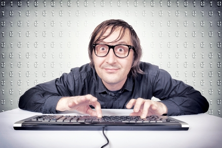 nerd glasses: Funny hacker typing on the keyboard