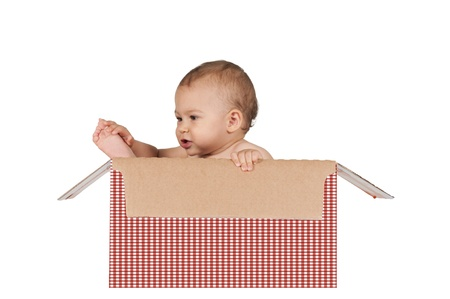 Happy baby in the box isolated on white background photo