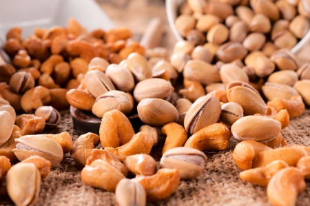 Selective focus in the middle of pistachio and cashew nuts mix