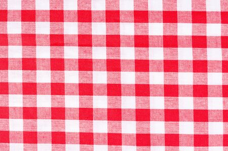 Red and white table cloth texture as background photo