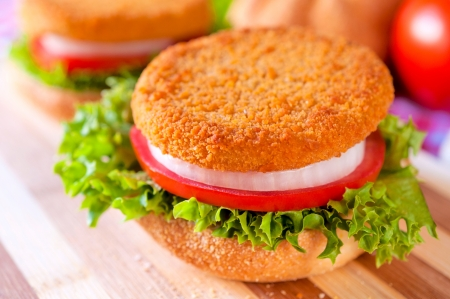 breadcrumbs: Selective focus on the fishburger on top of sandwich