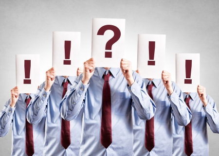Reluctance businessman holding question mark over his head