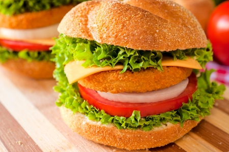 chicken burger: Fresh and fried fishburger with vegetables Stock Photo