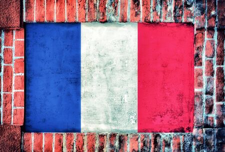 Franch flag in the old bricks wall photo
