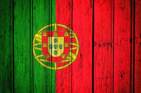 Portugal flag on the old wooden background Stock Photo - 21163596